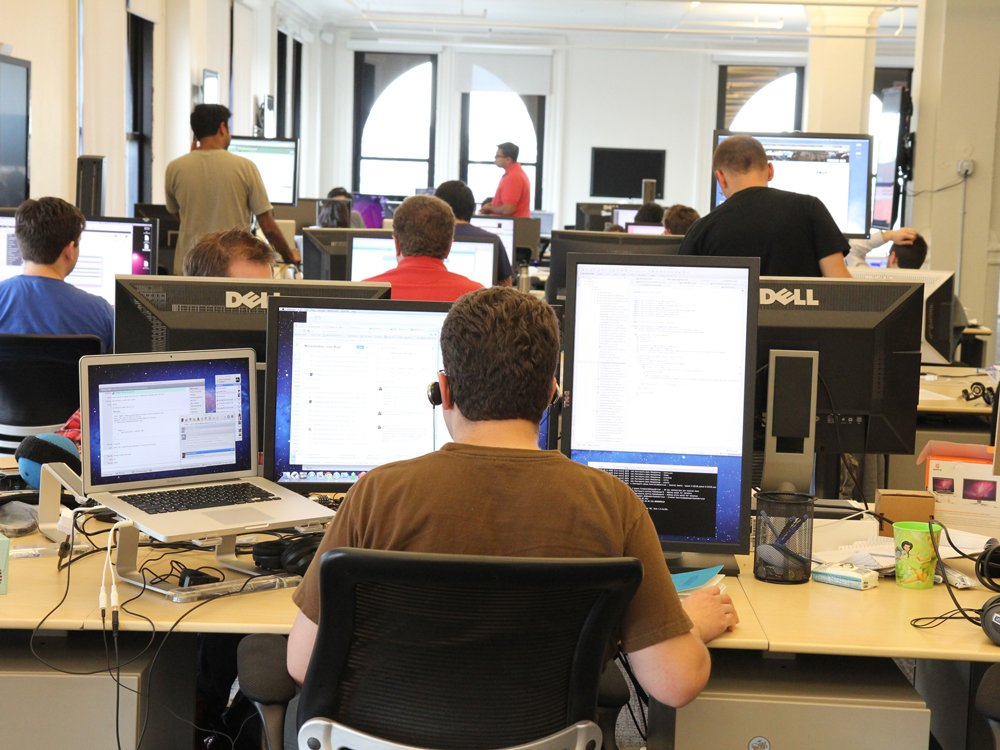 back-in-the-office-some-people-are-still-working-hard-at-their-desks